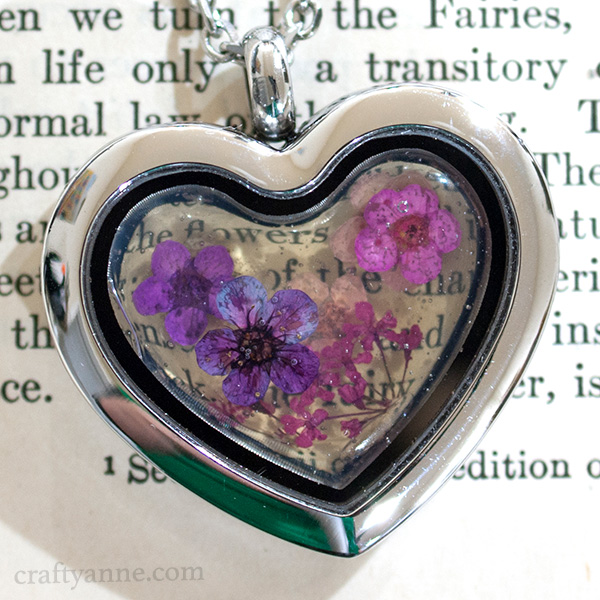 close up of my finished glass pressed flower pendant